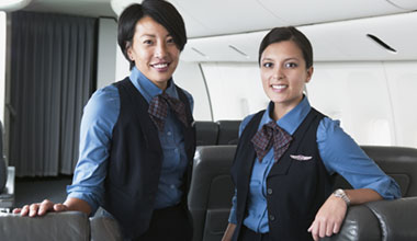Two flight attendants on a plane